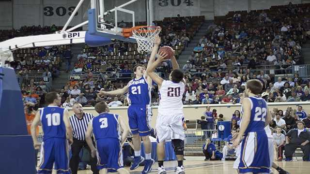 Hunter Hall (21) blocks the shot of a Weleetka player during the Class A boys championship finals.