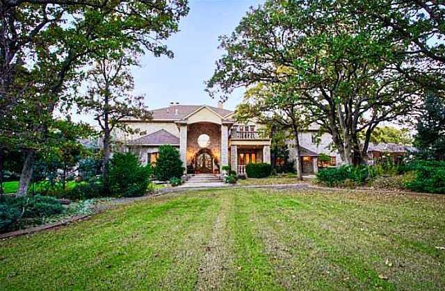 Built in 1999, this house sits on nearly five acres of land. It has five bedrooms and seven baths and all sorts of extras. For more information on this property, click here.