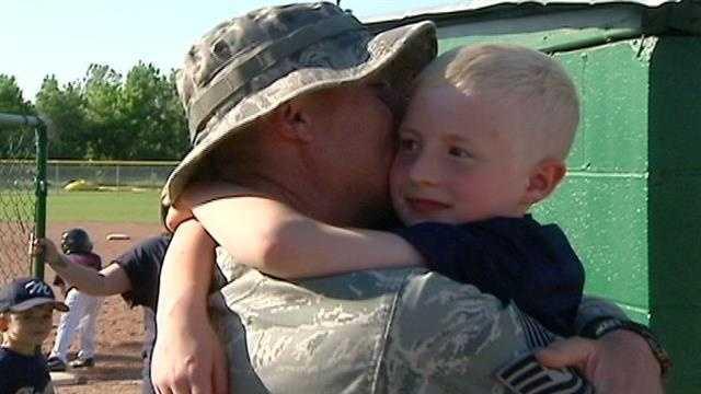 Airman surprises young son at baseball game