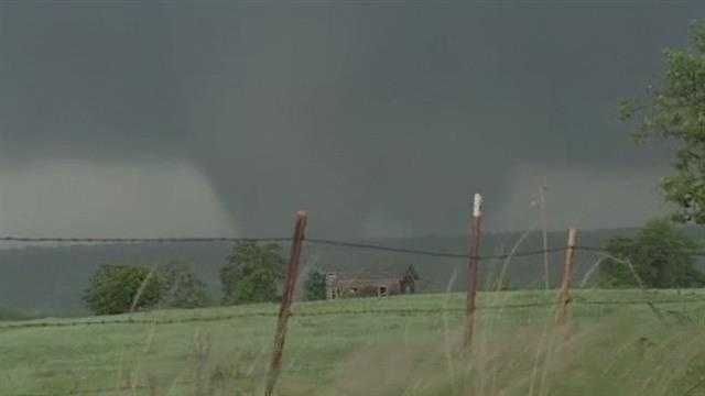 KOCO 5 News photojournalist Chris Lee filmed a large tornado that eventually hit the town of Carney.