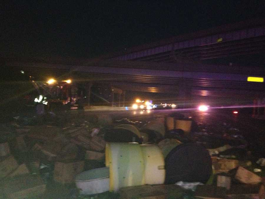 A truck carrying boxes of cups was knocked off Interstate 40. The driver is ok. Several people in care were taken to the hospital.