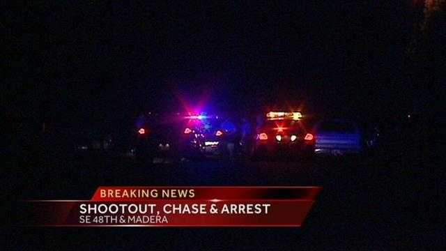 Police arrest one person after they say two cars were shooting at each other.