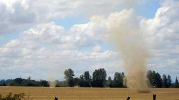 Dustnado (Dust devil): a small whirlwind or air vortex over land, visible as a column of dust and debris.