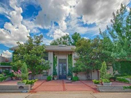 The asking price for this home in Oklahoma city is $1,595,000. It has four bedrooms, four full baths and four half baths spread over nearly 7,800 square feet of living space. For more information on this property, click here.