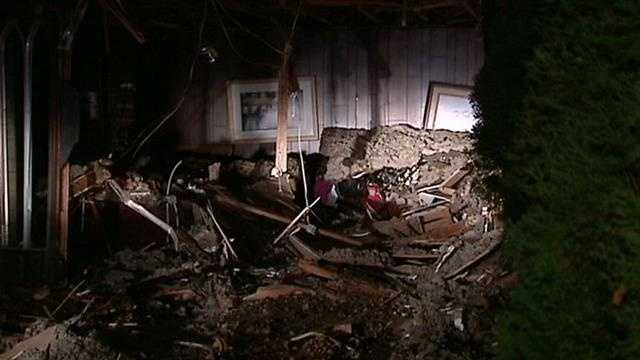 A dump truck pushed a van into a Mustang home causing extensive damage.