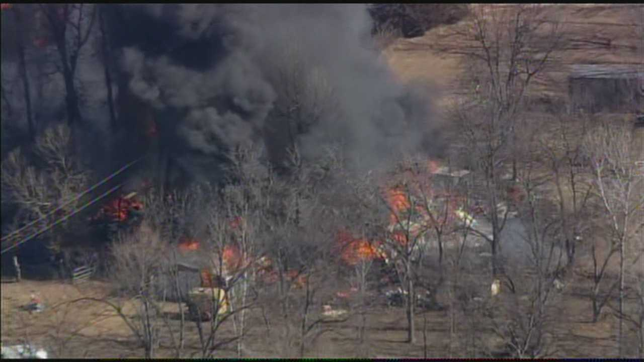 A fire in Luther is burning more than one structure Friday afternoon.