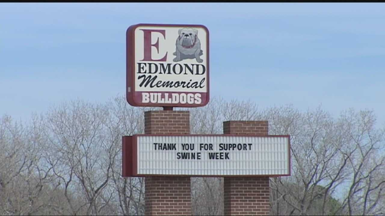 Edmond Memorial high school is under fire after a photo surfaced of two freshman girls licking peanut butter from the armpits of a freshman boy at an spirit week assembly.