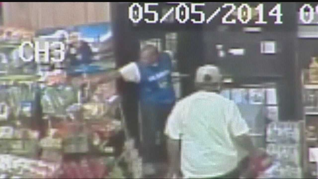 Police are looking for two men accused of robbing a convenience store at gunpoint for two cases of beer