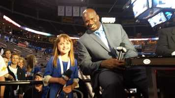 Olivia Kay. She also sang the National Anthem before the game. Click here to see the video.