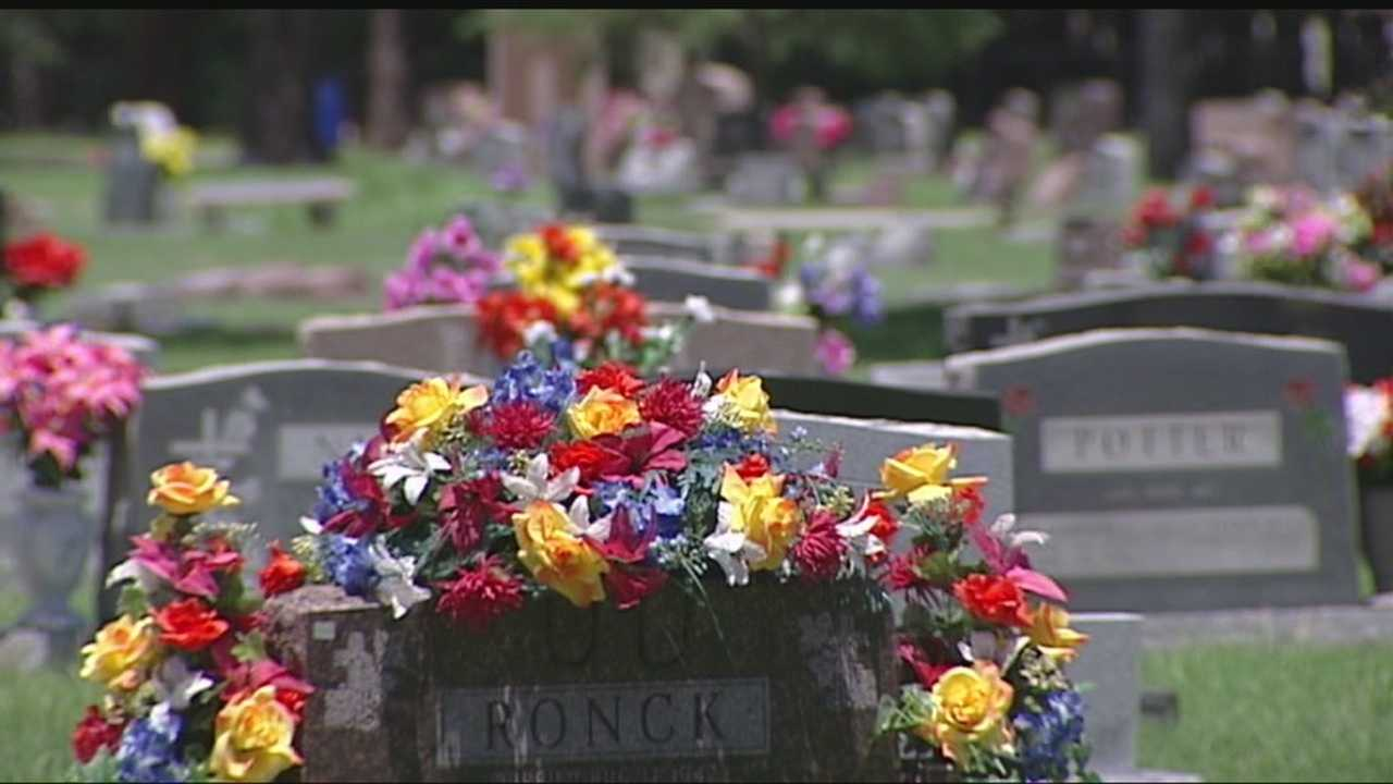 Two Enid women are facing charges of taking flowers from a cemetery.