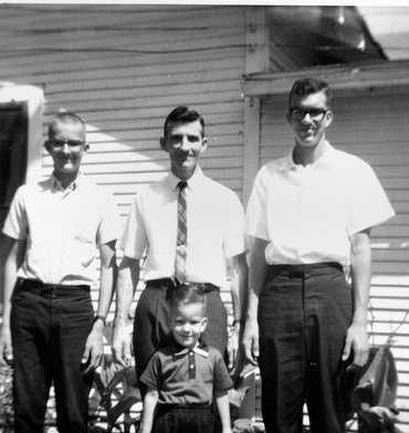 Dad in the middle, surrounded by three sons