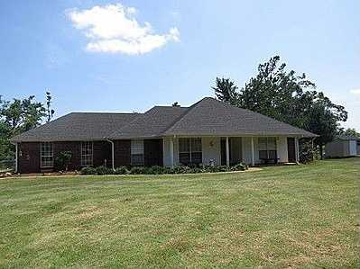 For $199,900 you can get this 4 bedroom, 2 bath custom home in Hugo.
