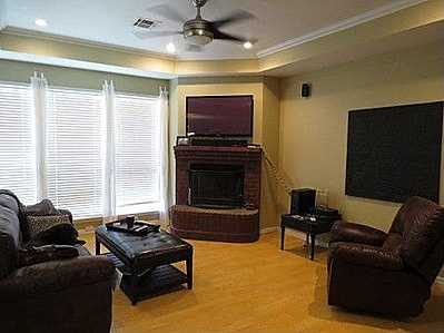 The house is in a secluded subdivision on 5 acres at the end of a cul-de-sac. It has vaulted ceilings in the living room and a log burning fireplace. There is a hot tub under the covered porch. See the listing.