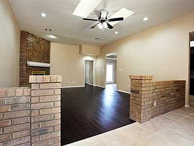 Living area has fireplace and brick room divider. Pretty kitchen, formal and informal dining areas with outside access to patio. Instant hot water in master bath. 4th bedroom could be office. See the listing.