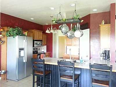 This home sits on a on acre lot and has an open floor plan with a large kitchen and breakfast area. It has a family room and backs up to an open field with a fantastic view. The seller is willing to pay $3,000 for closing costs or a carpet allowance. See the listing.