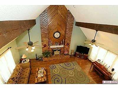 This home is on a cul-de-sac and has granite countertops, wood floors, excellent condition. Enjoy screened in back porch. See the listing.