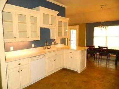 The home has an open floor plan, high ceilings and crown molding. It has a mother-in-law plan with lots of storage and the 2nd living room could be used as a formal dining or office. Backyard backs up to a field. See the listing.