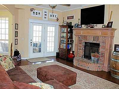 This home has an open floor plan with a lovely view of the neighborhood lake and walking trails. Kitchen features granite counters and stainless steel appliances. It has a 3-car garage and large closets in all rooms. See the listing.