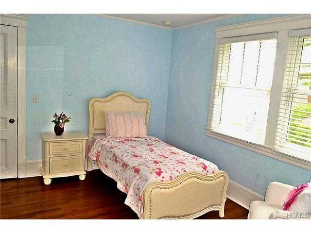 This is another bedroom. The home also has three baths.