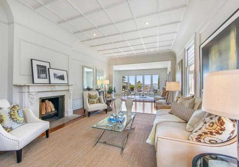 ... and beyond the entry hall is this open-plan family room ...