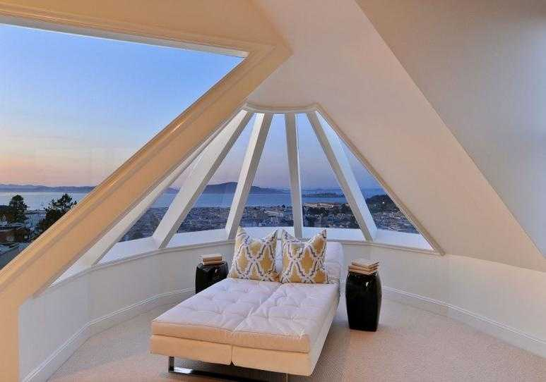 """A glassed-in """"turret"""" is one of the home's most eclectic touches."""