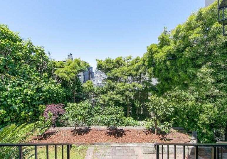 ... overlooking the backyard. The home sits on a 3,830-square-foot lot.