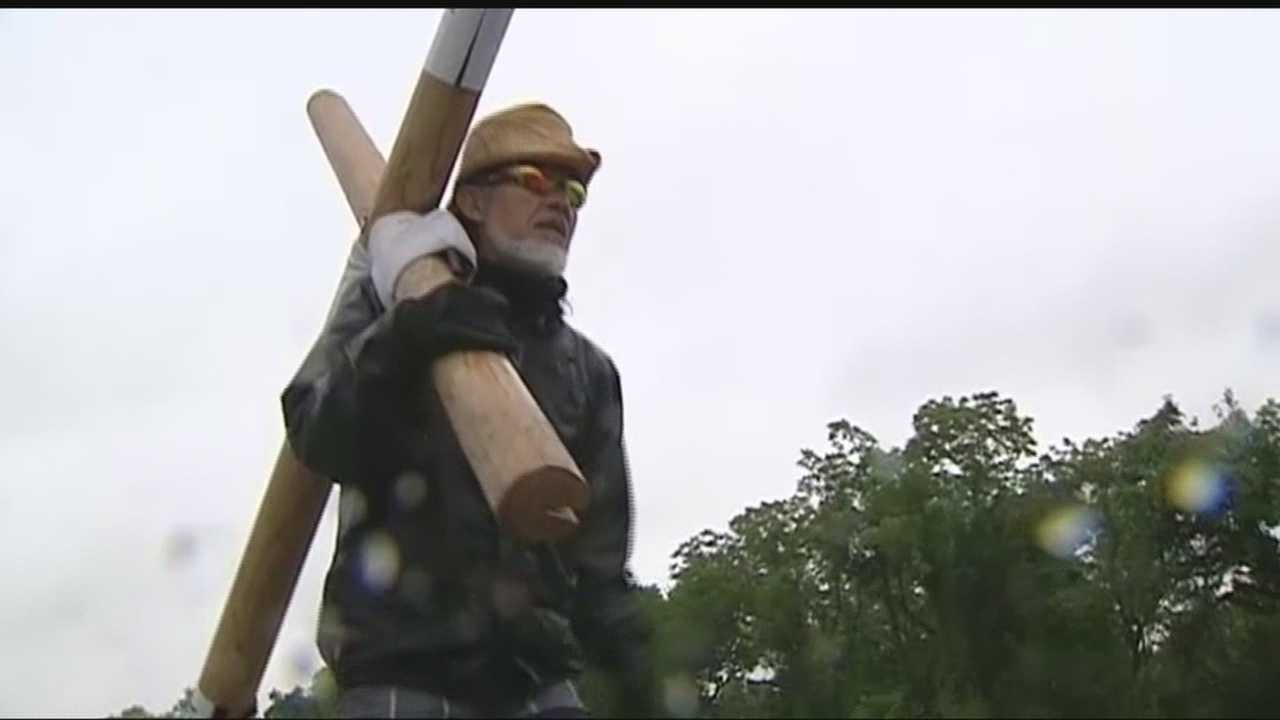 A Minister is traveling across the country carrying a cross, hoping to spread a simple message.