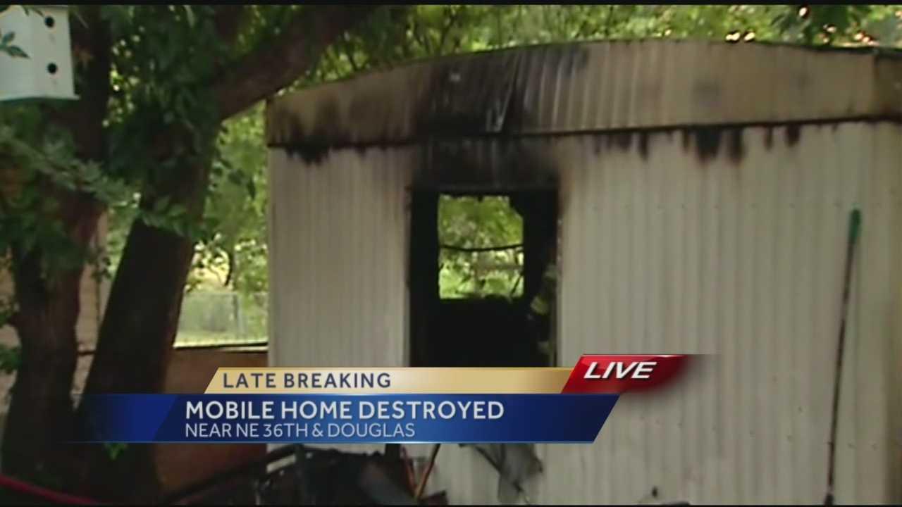 Man escapes Spencer mobile home fire