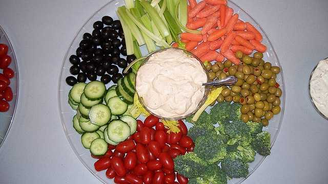 9. Make a dip. Sheknows.com says a low-fat dip or hummus with raw vegetables will make eating the vegetables easier.