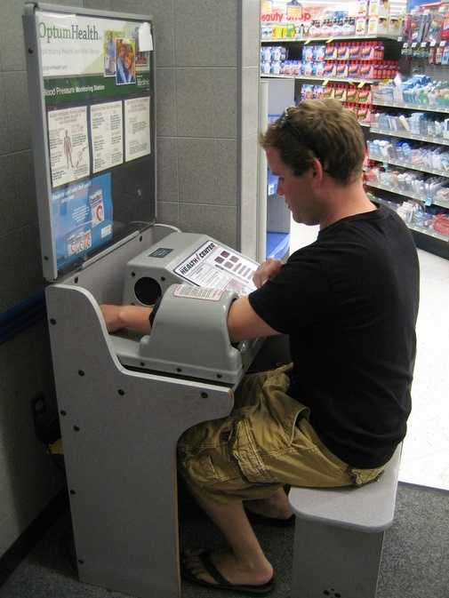 Employee got stuck in the blood pressure machine at the grocery store and couldn't get out.