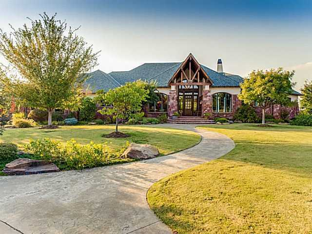 This home sits on 11 acres of land and has 4 bedrooms and seven baths. It's got everything from a wine cellar to a game room. For more information on this property, click here.