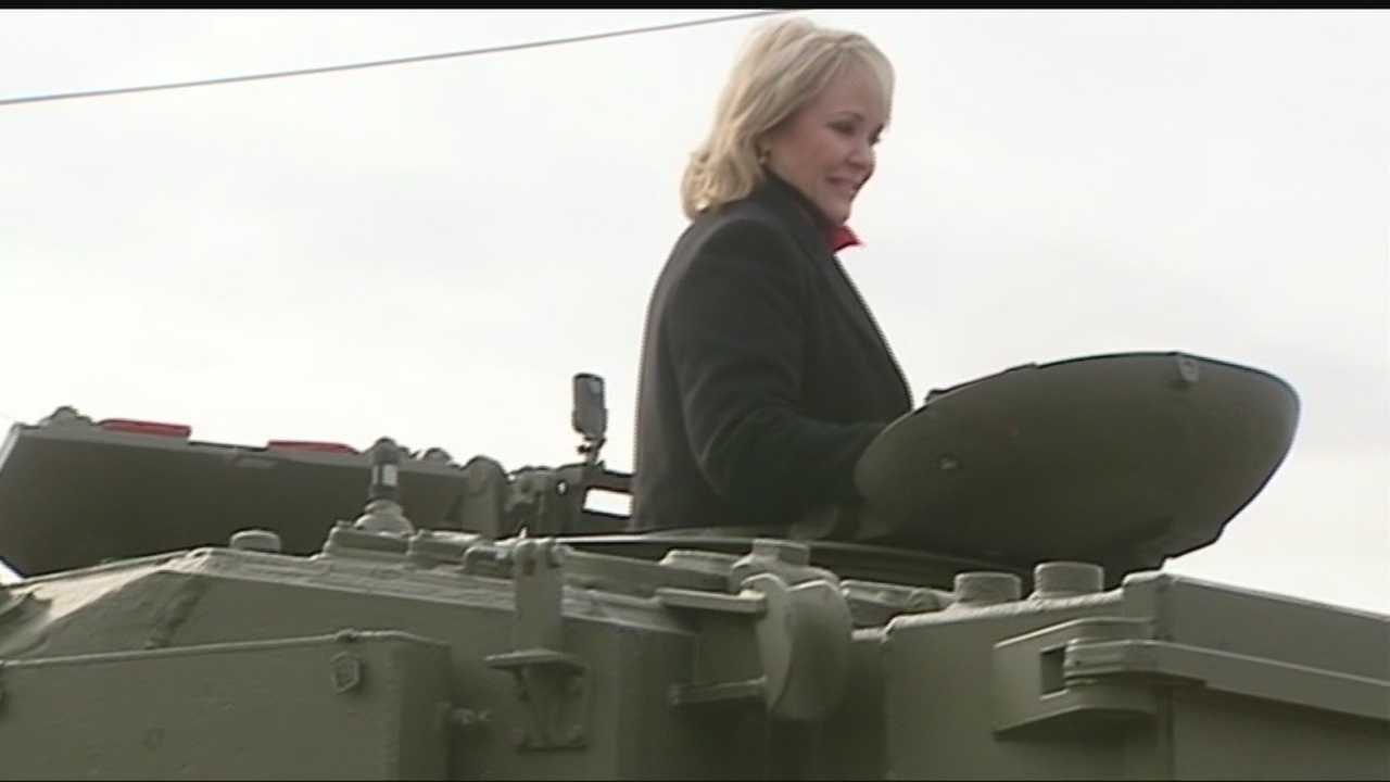 Gov. Mary Fallin rode in a tank and shot a gun at the grand opening of the Wilshire Gun Range on Friday.