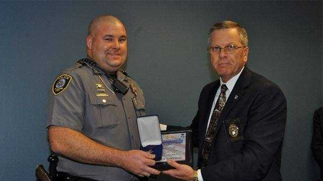 Sgt. Cody Koelsch receives an Order of the Purple Heart honor.