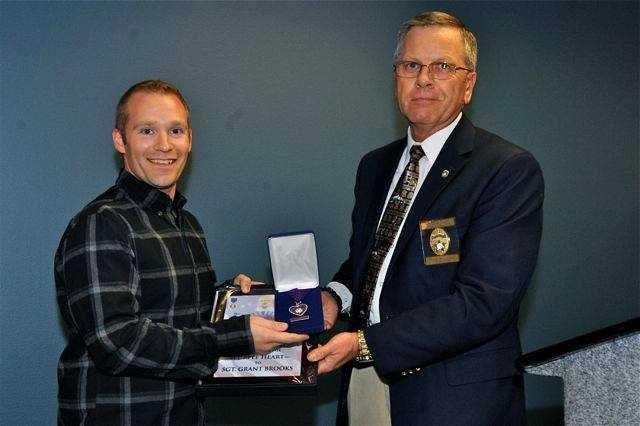 Sgt. Grant Brooks receives an Order of the Purple Heart honor.