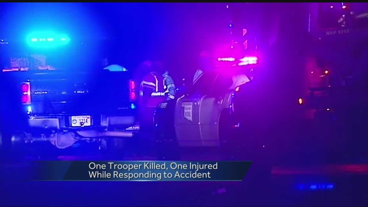One Oklahoma Highway Patrol trooper was killed and another is in serious condition after a car struck them Saturday evening.