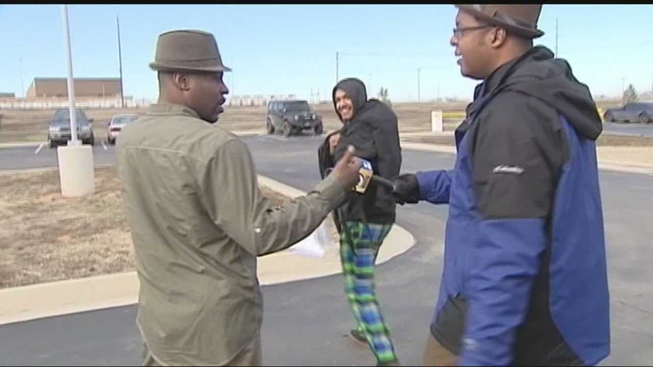 KOCO's Wendell Edwards talks to a teen who is accused in an alleged gang rape of a 15-year-old as he walks out of the Cleveland County Courthouse in Norman with his father.