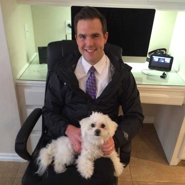 Meteorologist Brad Sowder and his puppy.