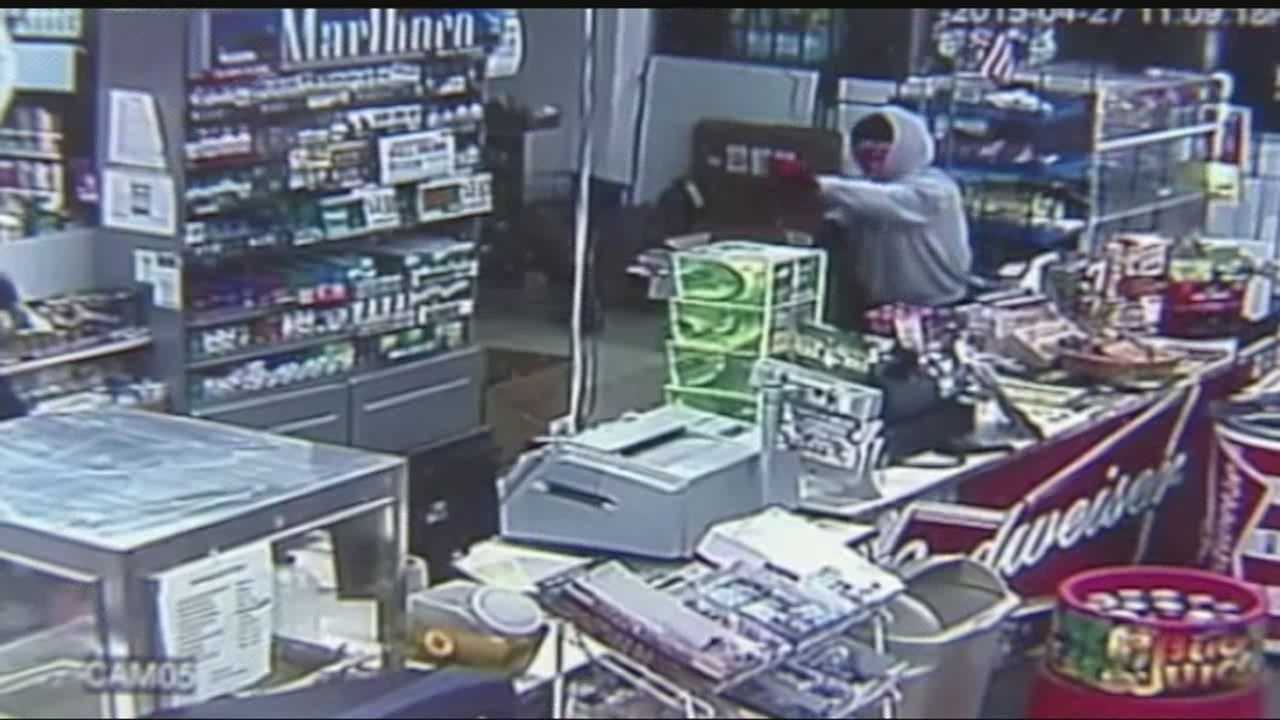 A store manager describes staring down the barrel of a gun during an armed robbery.