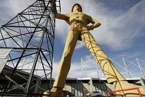 Visit the Golden Driller, a giant statue of an oil worker built in the 1950s. Photo from Flickr by David Schuttler.