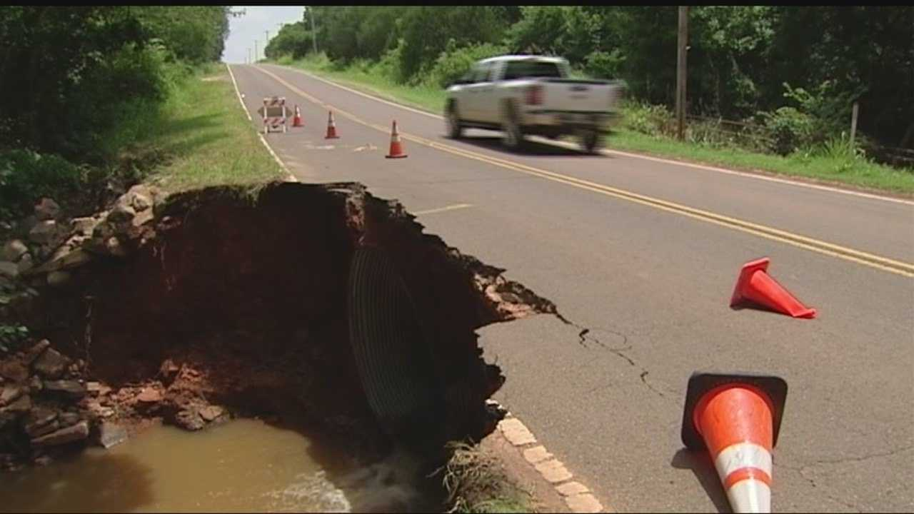 A Logan County commissioner is working to fix damaged roads and said repairs could cost almost $500,000.