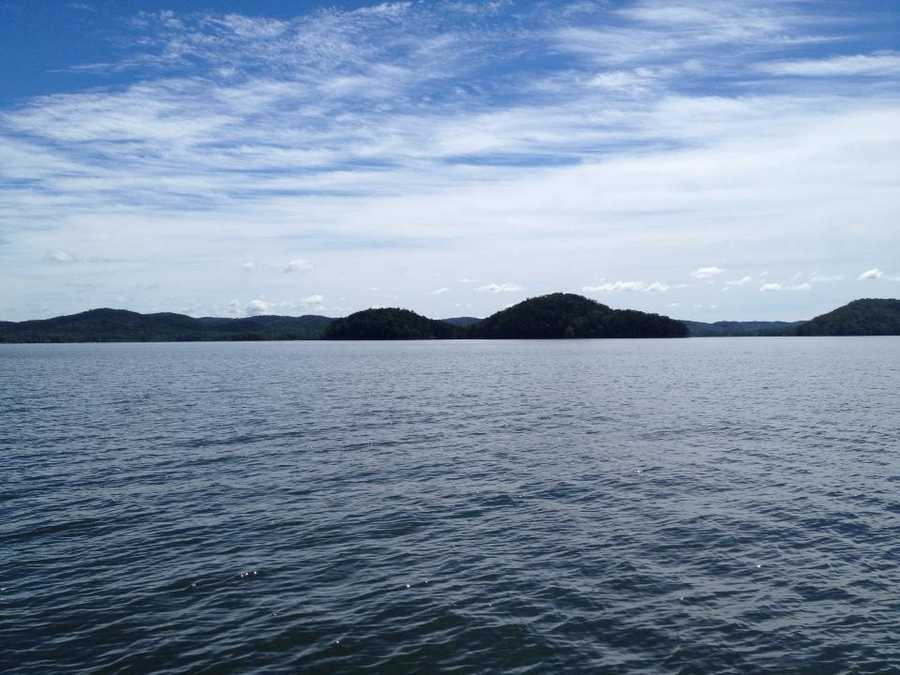 Soak in the views from Broken Bow Lake. And take a dip in the waters while you're at it.