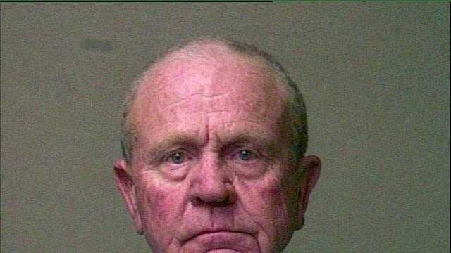 The mug shot is from a June 23, 2014 arrest.