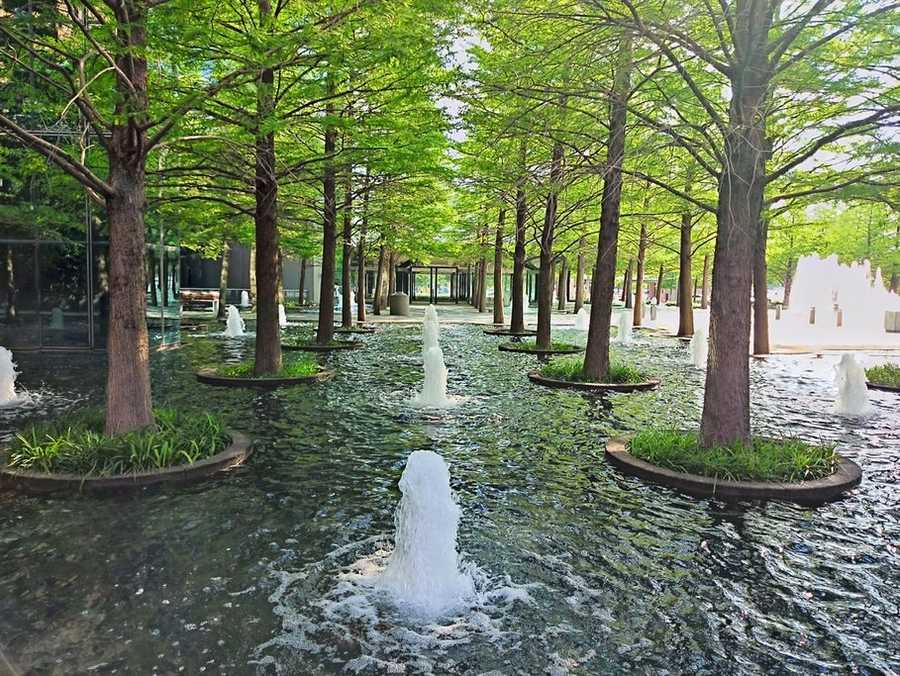 We're in the dog days of summer, and you can cool down at the Fountain Place. Grab lunch, find a place near the fountains and relax under the shade. Photo from Flickr by Payton Chung.
