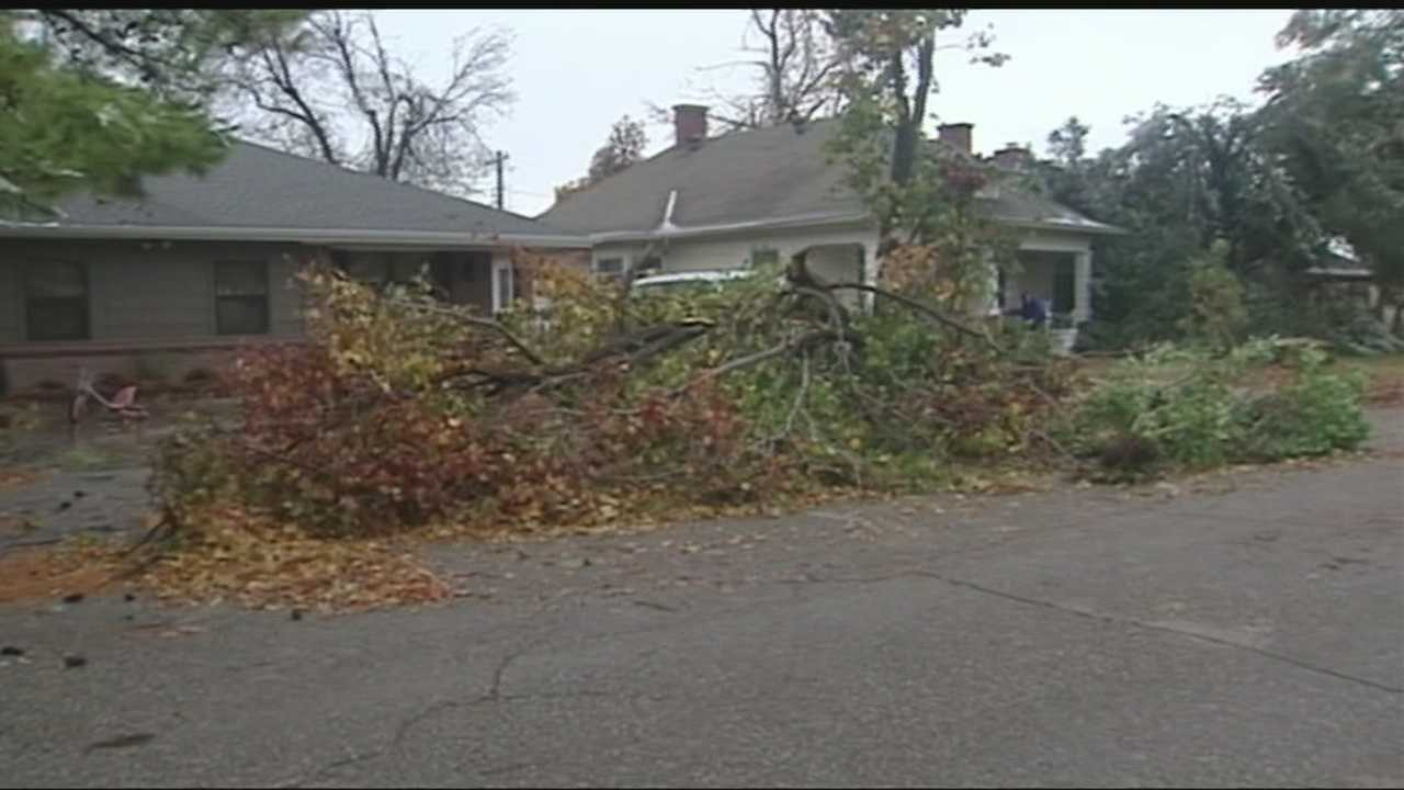 El Reno residents continue to clean up their properties after this weekend's ice storms caused parts of trees and power lines to be downed in the area.