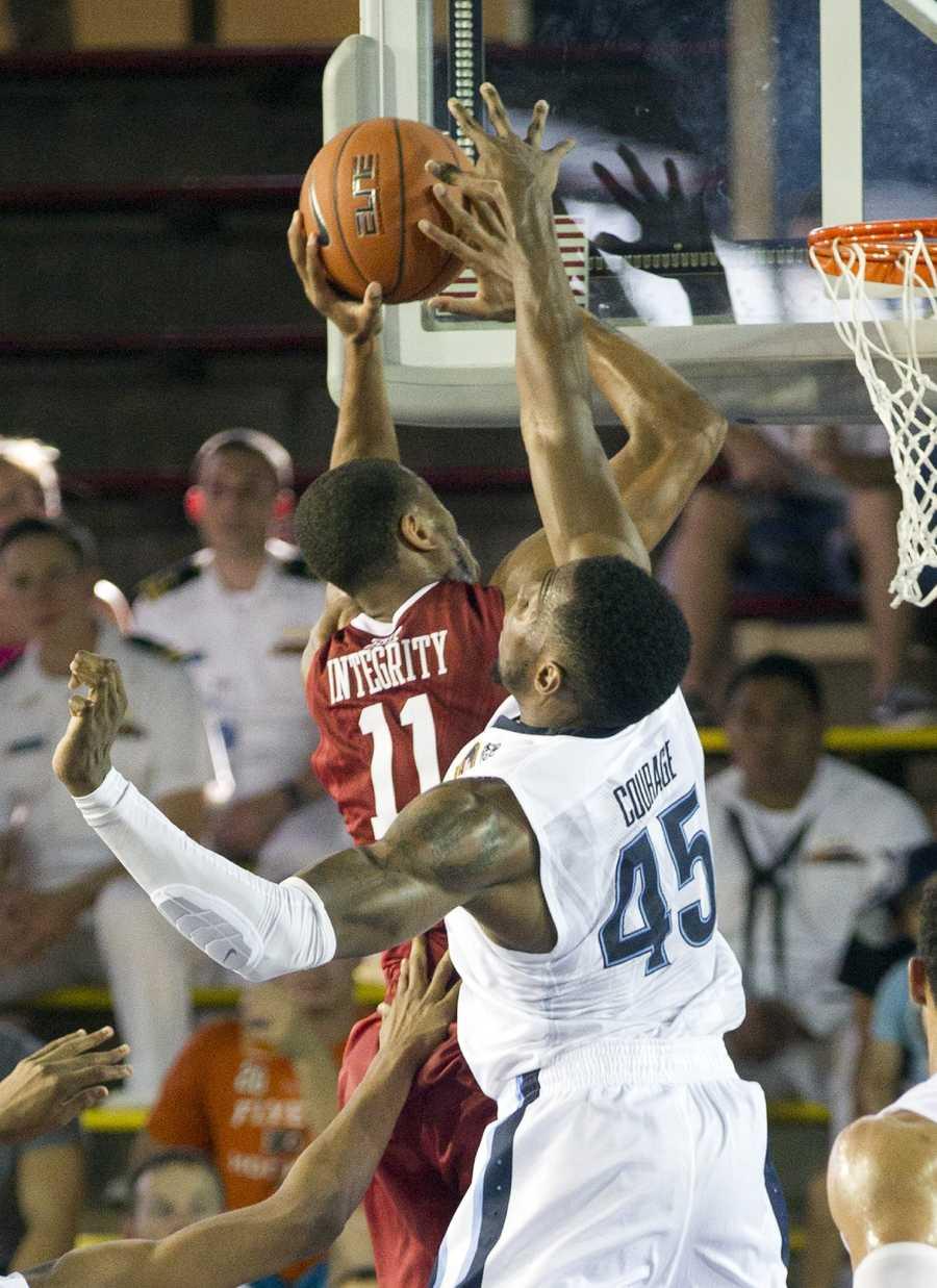 Oklahoma guard Isaiah Cousins (11) has his shot blocked by Villanova forward Darryl Reynolds (45) in the second half of an NCAA college basketball game at the Pearl Harbor Invitational on Monday, Dec. 7, 2015, in Honolulu. Oklahoma beat Villanova 78-55.