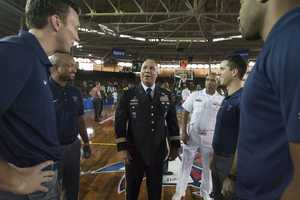 The Villanova coaching staff meets Army Lt. Gen. Anthony G. Crutchfield, center, who is the deputy commander of the United States Pacific Command before the start of an NCAA college basketball game at the Pearl Harbor Invitational on Monday, Dec. 7, 2015, in Honolulu.