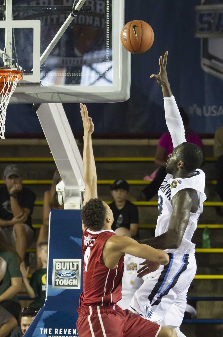 Villanova forward Daniel Ochefu, right, shoots over Oklahoma center Jamuni McNeace, left, in the first half of an NCAA college basketball game at the Pearl Harbor Invitational on Monday, Dec. 7, 2015, in Honolulu.