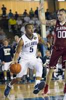 Villanova guard Phil Booth (5) drives the baseline while being defended by Oklahoma forward Ryan Spangler (00) in the second half of an NCAA college basketball game at the Pearl Harbor Invitational on Monday, Dec. 7, 2015, in Honolulu. Oklahoma beat Villanova 78-55.