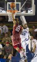 Oklahoma guard Jordan Woodard (10) takes a shot over Villanova forward Darryl Reynolds (45) in the second half of an NCAA college basketball game at the Pearl Harbor Invitational on Monday, Dec. 7, 2015, in Honolulu. Oklahoma defeated Villanova 78-55.