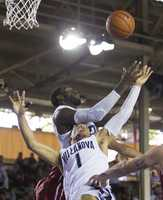 Villanova forward Daniel Ochefu, top, and his teammate guard Jalen Brunson (1) attempt to control a rebound while playing against Oklahoma in the second half of an NCAA college basketball game at the Pearl Harbor Invitational on Monday, Dec. 7, 2015, in Honolulu. Oklahoma defeated Villanova 78-55.